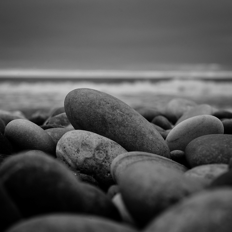 Gray pebbles on a beach at sunset Reportage on Porto, Portugal