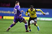 Oxford United midfielder Tarique Fosu-Henry  (11) sprints forward with the ball  under pressure from Shrewsbury Town defender Donald Love (17) during the EFL Sky Bet League 1 match between Oxford United and Shrewsbury Town at the Kassam Stadium, Oxford, England on 7 December 2019.