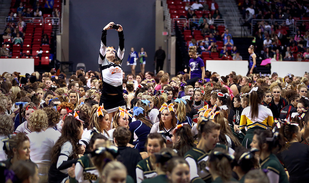 Falls City High School Senior Tabitha Nickell takes a picture amidst a sea of cheer leaders and dancers during the Nebraska State Cheer and Dance Championships Saturday at Heartland Events Center in Grand Island. (Independent/Matt Dixon)