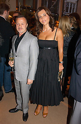 Fashion designer JACQUES AZAGURY and ELLA KRASNER at a party to celebrate 100 years of Chinese Cinema hosted by Shangri-la Hotels and Tartan Films at Asprey, New Bond Street, London on 25th April 2006.<br />