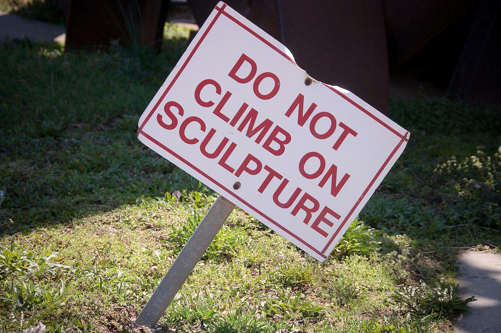 Do not climb on sculpture, sign
