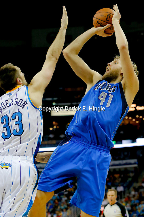 Apr 14, 2013; New Orleans, LA, USA; Dallas Mavericks power forward Dirk Nowitzki (41) shoots over New Orleans Hornets power forward Ryan Anderson (33) during the second half of a game at the New Orleans Arena. The Mavericks defeated the Hornets 107-89. Mandatory Credit: Derick E. Hingle-USA TODAY Sports