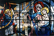 A stained glass window inside Our Lady of the Holy Rosary Church in Medford, Wis., depicts Mary giving a rosary to St. Dominic. Church tradition holds that the Virgin Mary appeared to St. Dominic in 1208 and revealed the rosary devotion to him. (Photo  by Sam Lucero).