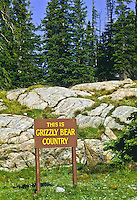 A sign warning visitors that they are in grizzly bear country.  Sign found along the Beartooth Highway in the Beartooth Mountains.  Wyoming.