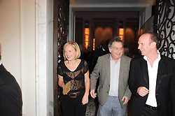 Left to right, MARIELLA FROSTRUP, STEPHEN FREARS and SIMON SEBAG-MONTEFIORE at the Liberatum Dinner hosted by Ella Krasner and Pablo Ganguli in honour of Sir V S Naipaul at The Landau at The Langham, Portland Place, London on 23rd November 2010.