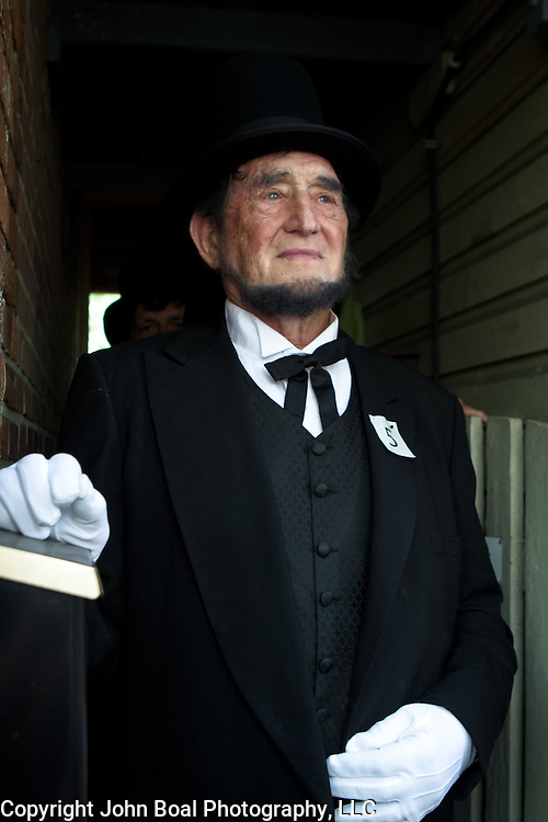 Douglas Kirkland prepares himself for the Abraham Lincoln look-alike contest at the Shriver House Museum in Gettysburg, PA, during the Sesquicentennial Anniversary of the Battle of Gettysburg on Wednesday, July 3, 2013.  John Boal Photography