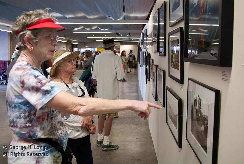 """Louisiana Road Trip"" exhibit in the Grandstand at the 2010 New Orleans Jazz & Heritage Festival presented by the New Orleans Photo Alliance; Nick Spitzer, juror"