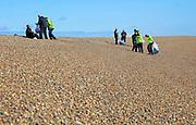 Border Force staff conduct training exercise on beach at Shingle Street, Suffolk, England, UK