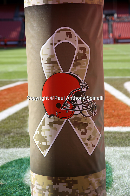 The goal post pad is decorated with the Cleveland Browns logo and a salute to the military logo before the 2015 week 8 regular season NFL football game against the Arizona Cardinals on Sunday, Nov. 1, 2015 in Cleveland. The Cardinals won the game 34-20. (©Paul Anthony Spinelli)