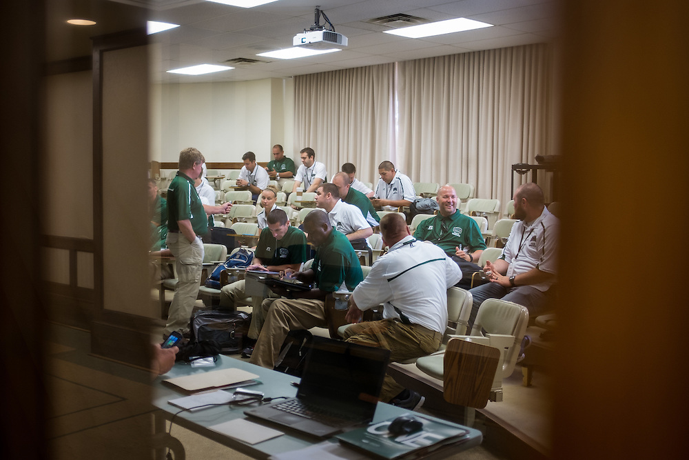 Master's in Athletic Administration students chat after the conclusion of class on Friday, June 26, 2015. © Ohio University / Photo by Rob Hardin