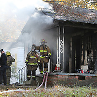 Tupelo fire fighters work to put a house fire in the 100 block of South Highland Drive Tuesday afternoon.