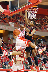 08 December 2007: Emmanuel Holloway makes a leaping pass under the basket as Darnell Wilks guards the net. The Cincinnati Bearcats take a loose against the Illinois State Redbirds 62-52 on Doug Collins Court in Redbird Arena on the campus of Illinois State University in Normal Illinois.