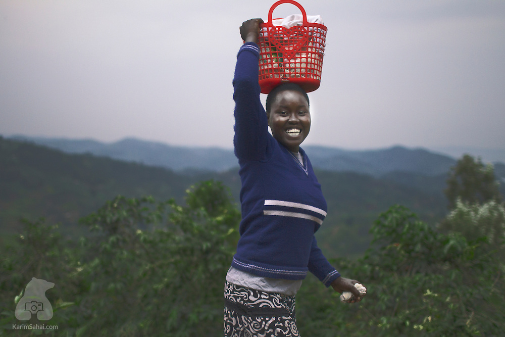 Young woman carrying groceries, Rwanda.