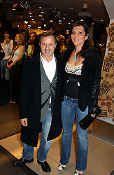 Fashion designer JACQUES AZAGURY and ELLA KRASNER at a Topshop hosted Jumbo Thrift Sale - a sale of designer fashion, in association with the Terence Higgins Trust for World Aids Day, held at Topshop, Oxford Circus, London on 1st December 2004.<br />