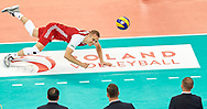 Poland, Warsaw - 2017 August 24: Pawel Zatorski from Poland dives for the ball while match Poland versus Serbia during LOTTO EUROVOLLEY POLAND 2017 - European Championships in volleyball at Stadion PGE Narodowy on August 24, 2017 in Warsaw, Poland.<br /> <br /> Mandatory credit:<br /> Photo by © Adam Nurkiewicz<br /> <br /> Adam Nurkiewicz declares that he has no rights to the image of people at the photographs of his authorship.<br /> <br /> Picture also available in RAW (NEF) or TIFF format on special request.<br /> <br /> Any editorial, commercial or promotional use requires written permission from the author of image.
