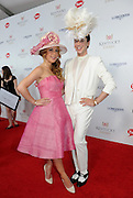 Tara Lipinski and Johnny Weir walk the Kentucky Derby Red Carpet, Saturday, May 3, 2014, in Louisville, Ky. Longines, the Swiss watchmaker known for its famous timepieces, is the Official Watch and Timekeeper of the 140th annual Kentucky Derby. (Photo by Diane Bondareff/Invision for Longines/AP Images)