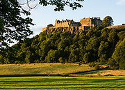 Once the capital of Scotland, Stirling is visually dominated by Stirling Castle. Historically, Stirling controlled a strategic position (until the 1890s) as the lowest bridging point of the River Forth before it broadens towards the Firth of Forth, making it the gateway to the Scottish Highlands. One of the principal royal strongholds of the Kingdom of Scotland, Stirling was created a royal burgh by King David I in 1130. Stirling Castle sits atop Castle Hill, an intrusive crag, which forms part of the Stirling Sill geological formation. Most of the stronghold's main buildings date from the 1400s and 1500s, when it peaked in importance. The outer defences fronting the town date from the early 1700s. Before the union with England, Stirling Castle was also one of the most used of the many Scottish royal residences, serving as both a palace and a fortress. Scotland is now part of the United Kingdom, in Europe. Several Scottish Kings and Queens have been crowned at Stirling, including Mary, Queen of Scots in 1542, and others were born or died there. Stirling Castle has suffered at least eight sieges, including several during the Wars of Scottish Independence, with the last being in 1746, when Bonnie Prince Charlie unsuccessfully tried to take the castle.