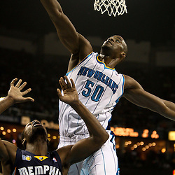 April 1, 2011; New Orleans, LA, USA; New Orleans Hornets center Emeka Okafor (50) is called for goal tending on a shot by Memphis Grizzlies shooting guard Tony Allen (9) during the second quarter at the New Orleans Arena.    Mandatory Credit: Derick E. Hingle