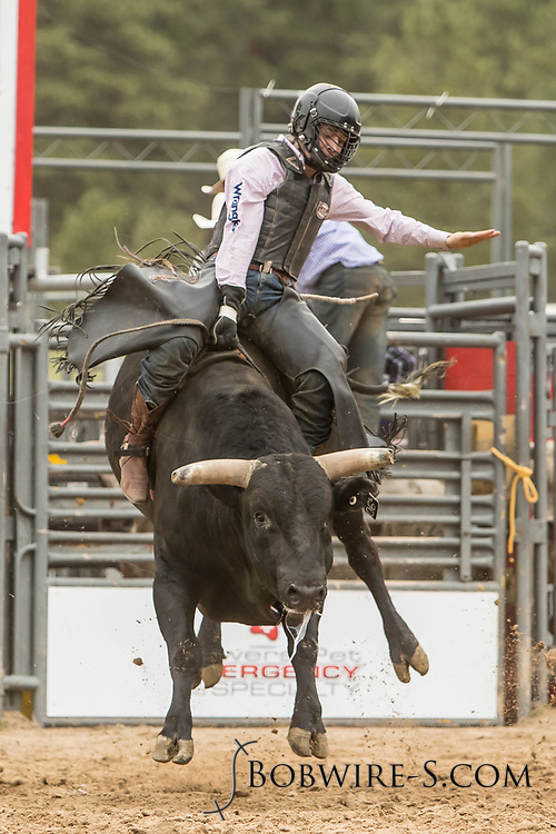 Bull rider Trey Kimzey rides Summit Pro Rodeo's Thunder Rolls during the third performance of the Elizabeth Stampede on Sunday, June 3, 2018.