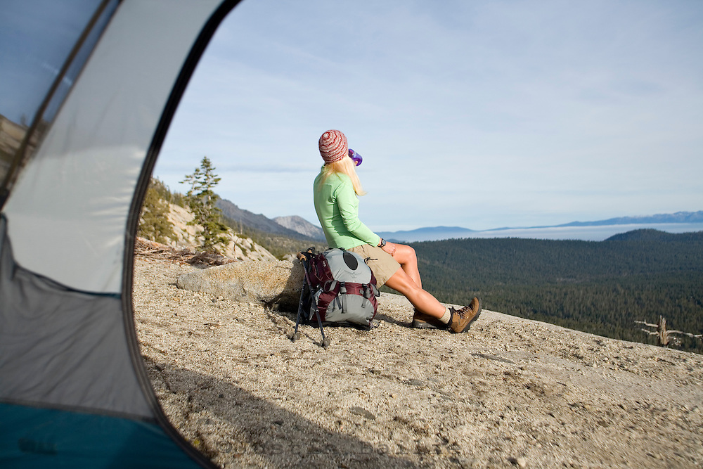 Woman camping near Lake Tahoe, CA