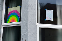 © Licensed to London News Pictures. 30/03/2020. London, UK. Hand painted picture of a colourful rainbow is displayed in a window of a house in north London. Rainbows are used as a symbol of peace and hope as coronavirus lockdown continues. Photo credit: Dinendra Haria/LNP