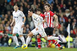 22.01.2012, Santiago Bernabeu Stadion, Madrid, ESP, Primera Division, Real Madrid vs Athletic Bilbao, 1. Spieltag, Nachtrag, im Bild Real Madrid's Mesut Ozil and Athletic de Bilbao's Fernando Amorebieta // during the football match of spanish 'primera divison' league, 1th round, supplement, between Real Madrid and Athletic Bilbao at Santiago Bernabeu stadium, Madrid, Spain on 2012/01/22. EXPA Pictures © 2012, PhotoCredit: EXPA/ Alterphotos/ Cesar Cebolla..***** ATTENTION - OUT OF ESP and SUI *****