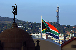 PRETORIA, SOUTH AFRICA - APRIL-27-2004 - The sun shines on the South African flag at the Union Buildings before the start of the inauguration ceremony for South African President Thabo Mbeki , which marks the 10th Anniversary of the fall of Apartheid in South Africa. (PHOTO © JOCK FISTICK)