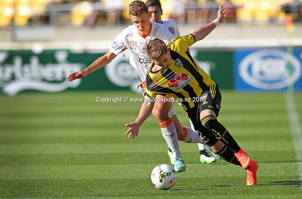 Phoenix' Tyler Boyd is dragged down in a tackle by Brisbane Roar' Daniel Bowles during the A-League football match between the Wellington Phoenix & Brisbane Roar at Westpac Stadium, Wellington. 4th January 2015. Photo.: Grant Down / www.photosport.co.nz