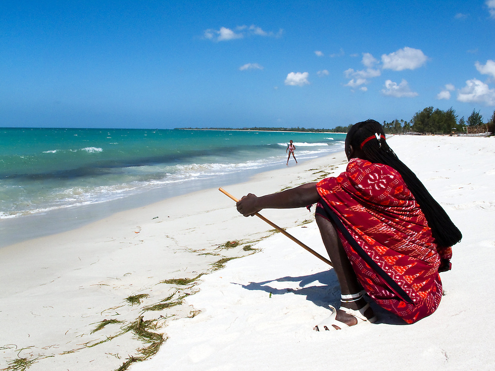 Dar es Salaam, Tanzania. 2010<br /> <br /> A Maasai warrior sits on a beach near Dar es Salaam, Tanzania