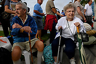 Jerry McCarthy and Florence Collins, who have been together for 25 years, line up for shelter in the Germain Arena in preparation for Hurricane Irma in Estero, Florida, U.S., September 8, 2017. REUTERS/Bryan Woolston