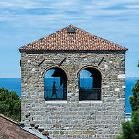 A man walks in the the bell tower of San Giusto in  Trieste, Italy.