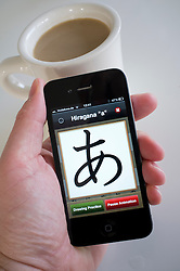 Student learning to write Japanese using educational application on an iPhone 4g smart phone