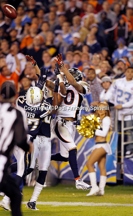 Denver Broncos wide receiver Jabar Gaffney (10) leaps while trying to catch a second quarter end zone pass while covered by San Diego Chargers safety Paul Oliver (27) during the NFL week 11 football game against the San Diego Chargers on Monday, November 22, 2010 in San Diego, California. The Chargers won the game 35-14. (©Paul Anthony Spinelli)