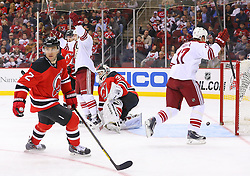 Mar 27, 2014; Newark, NJ, USA; The Phoenix Coyotes celebrate a goal by Phoenix Coyotes defenseman Chris Summers (20) (not shown) on New Jersey Devils goalie Martin Brodeur (30) during the second period at Prudential Center.