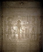 Egyptian Tomb relief showing Isis and Horus receiving offerings from a Pharaoh.