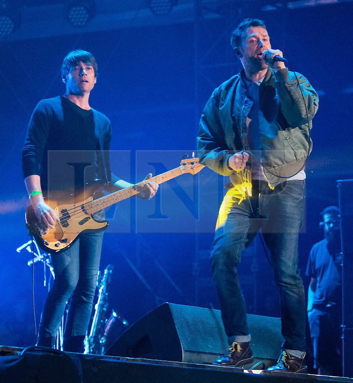 © Licensed to London News Pictures. 13/06/2015. Isle of Wight, UK.   Blur performing live at Isle of Wight Festival 2015, Day 3 Saturday,headlining the main stage.  In this picture - Alex James (left), Damon Albarn (right).   Headline acts include The Prodigy, Blur and Fleetwood Mac.   Photo credit : Richard Isaac/LNP
