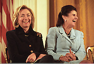 First Lady Hillary Clinton and Leah Rabin, widow of Israeli Prime Minister Yitzhak Rabin, share a light moment during a ceremony in the East Room of the White House, Washington, DC 1998. (© Photo by Roger M. Richards)