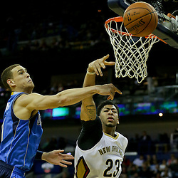 Jan 6, 2016; New Orleans, LA, USA; New Orleans Pelicans forward Anthony Davis (23) and Dallas Mavericks forward Dwight Powell (7) reach for a rebound during the second half of a game at the Smoothie King Center. The Mavericks defeated the Pelicans 100-91. Mandatory Credit: Derick E. Hingle-USA TODAY Sports