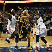 Skylar Diggins, (centre), Tulsa Shock, drives to the basket between Chiney Ogwumike and Allison Hightower, (right), Connecticut Sun, during the Connecticut Sun Vs Tulsa Shock WNBA regular season game at Mohegan Sun Arena, Uncasville, Connecticut, USA. 3rd July 2014. Photo Tim Clayton