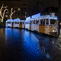BUDAPEST, HUNGARY - DECEMBER 07:  The traditional special festive Christmas lit Tram n2  crosses the square in front of the Hungarian Parliament on December 7, 2017 in Budapest, Hungary. The traditional Christmas market and lights will stay until 31st December 2017.