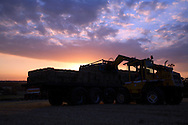 Loading harvested hay at sunset