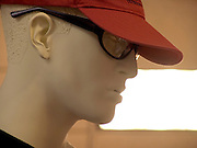 close up of a classic faced mannequin head with cap