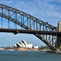 Sydney Harbour Bridge in Sydney, Australia<br /> Nicknamed The Coat Hanger, the Sydney Harbour Bridge is a 3,770 foot span over Port Jackson connecting The Rock and Milsons Point. It carries auto traffic along the Bradfield Highway, a railway line plus a lane for pedestrians and cyclists. Popular attractions are the lookout and a 3.5 hour bridge climb. On the right are two of the four, 292 foot pylons constructed with hand-cut granite from a quarry in Moruya, almost 200 miles from Sydney. In the background below the 440 foot steel arch is the Sydney Opera House.