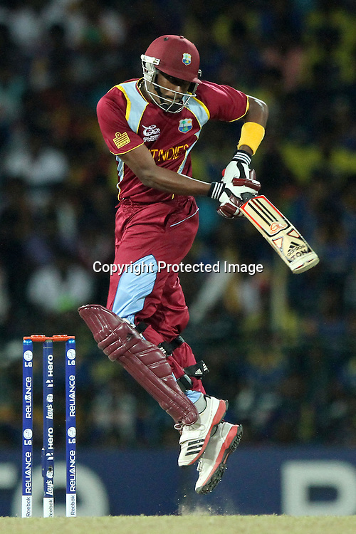 West Indies cricketer Dwayne Bravo bats during the ICC World Twenty20 final between Sri Lanka and the West Indies held at the Premadasa Stadium in Colombo, Sri Lanka on the 7th October 2012.<br /> <br /> Photo by Sanka vidanagama/SPORTZPICS/PHOTOSPORT