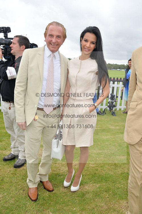 GEOFFREY KENT and his wife OTAVIA at the Cartier Queen's Cup Final polo held at Guards Polo Club, Smith's Lawn, Windsor Great Park, Egham, Surrey on 15th June 2014.