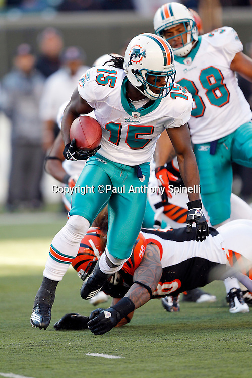 Miami Dolphins wide receiver Davone Bess (15) runs with the ball during the NFL week 8 football game against the Cincinnati Bengals on Sunday, October 31, 2010 in Cincinnati, Ohio. The Dolphins won the game 22-14. (©Paul Anthony Spinelli)