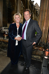 """STEPHEN & KATHY ARNOTT at a private view to view """"The Coronation Theatre: Portrait of Her Majesty Queen Elizabeth II"""" painted by Ralph Heimans held at Westminster Abbey, London on 12th September 2013."""