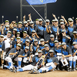 Jun 25, 2013; Omaha, NE, USA; UCLA Bruins celebrate with the championship trophy after game 2 of the College World Series finals against the Mississippi State Bulldogs at TD Ameritrade Park. UCLA defeated Mississippi State 8-0. Mandatory Credit: Derick E. Hingle-USA TODAY Sports