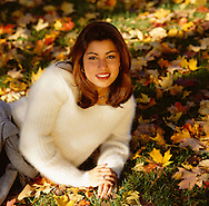 Woman posing in the autumn grass