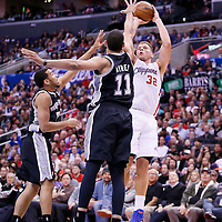 16 December 2013: Los Angeles Clippers power forward Blake Griffin (32) takes a jumpshot over San Antonio Spurs power forward Jeff Ayres (11) during the Los Angeles Clippers 115-92 victory over the San Antonio Spurs at the Staples Center, Los Angeles, California, USA.
